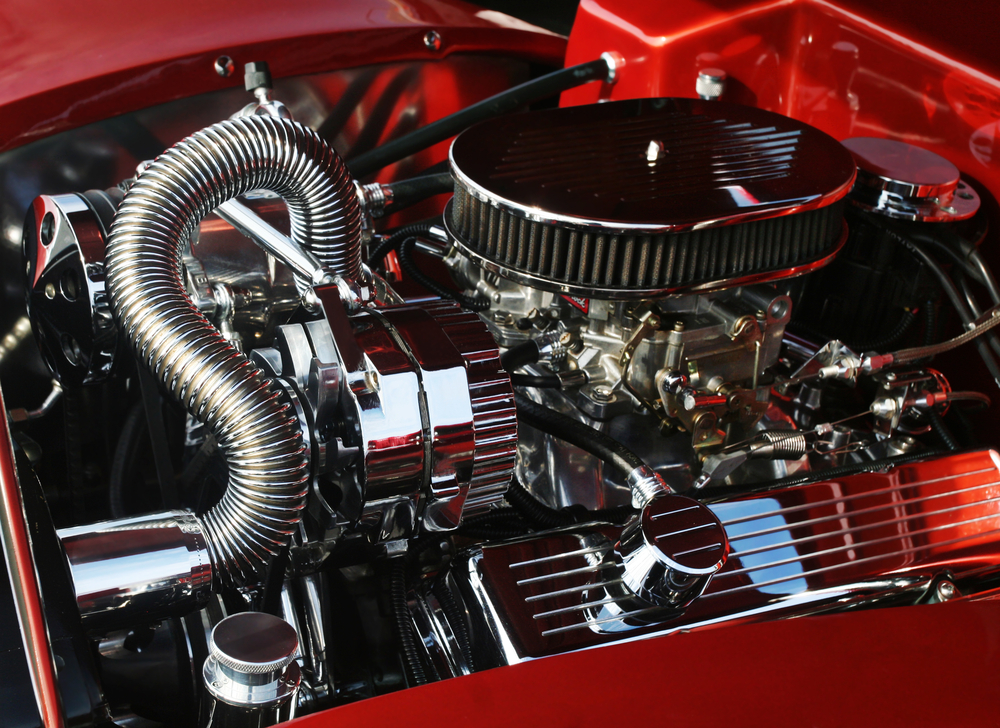 image of high precision motor engine for car - motor racing companies use freight ferries